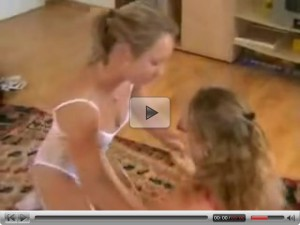 Lesbian Girls lick and play with Strap on